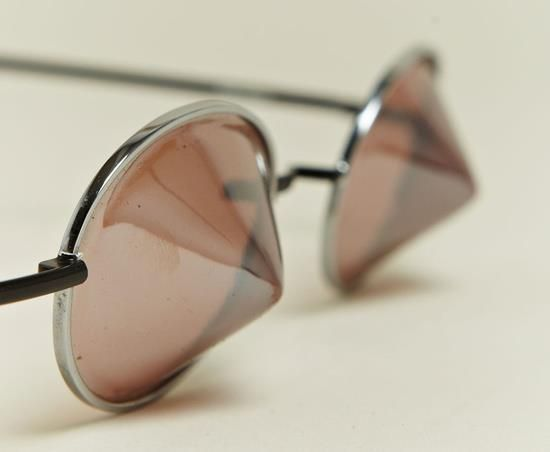 Issey Miyake's conical sunglasses.