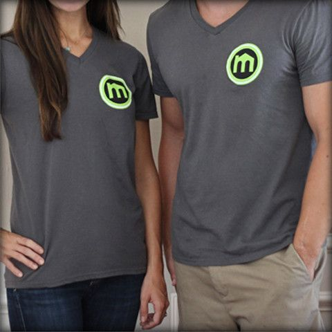 V-Neck Tee.  As with everything else we do, for every shirt we sell we will give away a pair of socks to someone in need. $24