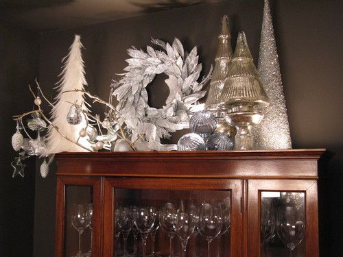 Christmas decorating above china cabinet in dining room This