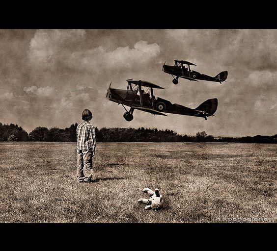 A little Hero's Dream  When I was a little boy I wanted to become a pilot… Now I fly… but not with a plane…   HKD  Als Junge wollte ich Pilot und ein Held werden. Heute fliege ich… aber nicht mit einem Flugzeug…   HKD  Ich war übrigens auf einer Flugschau und habe mir einen kleinen Rundflug gestattet. Ich fliege wahnisinnig gerne... :-)  Die Flugzeuge und das Kind habe ich dort fotografiert.... Allerdings habe ich dieses Bild mit Photoshop zu einer kleinen Geschichte gestaltet.  HKD