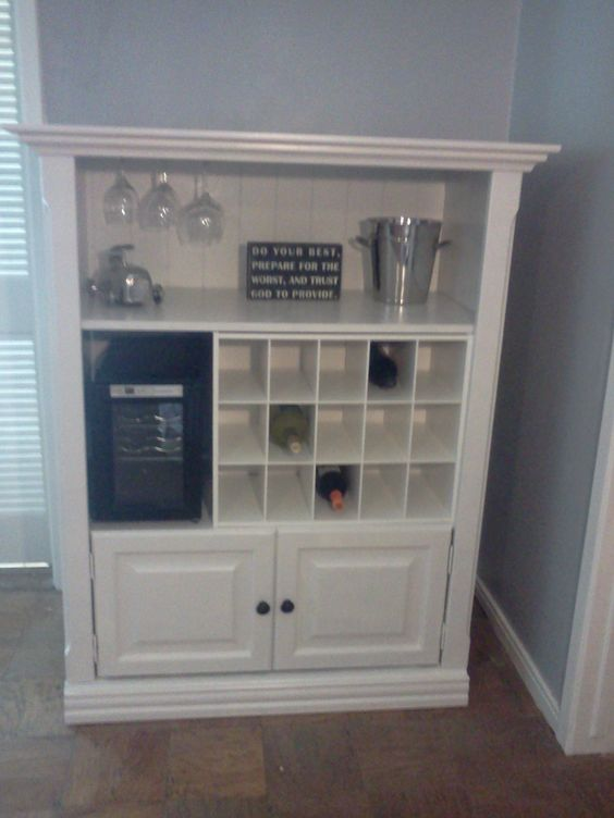 pinner says~ My daughter redid an old, painted black, entertainment center the movers broke and refashioned it into a wine bar.  Mama is so proud!