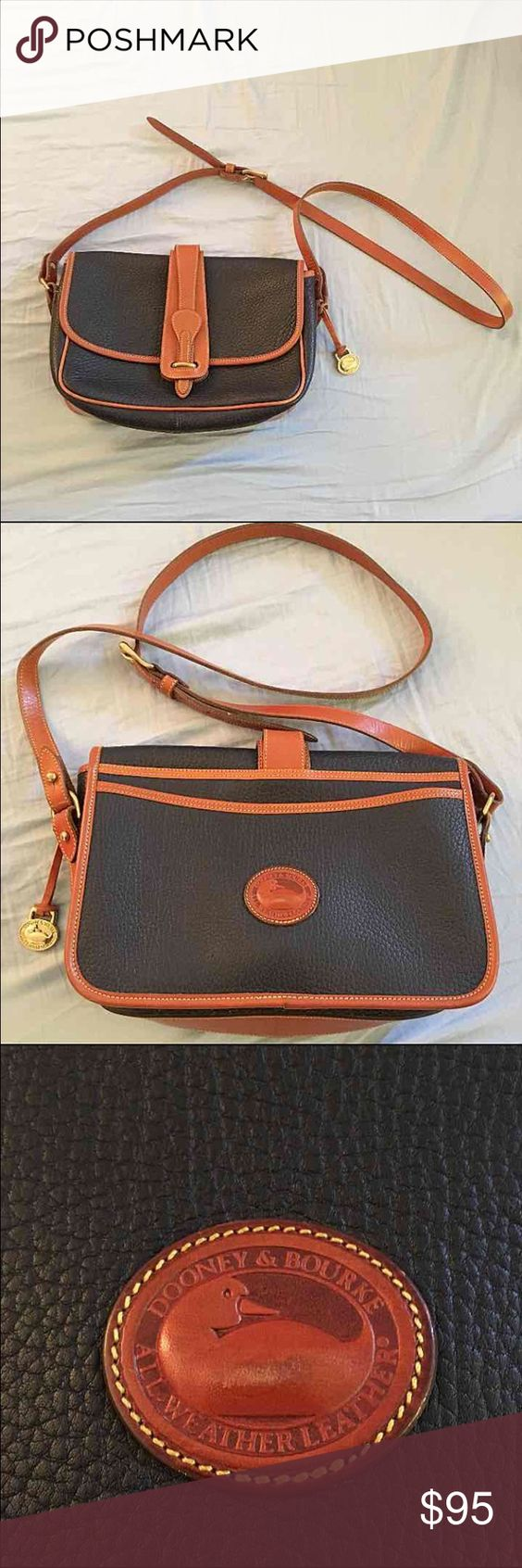 Dooney & Bourke purse Navy and tan leather with suede interior. 100% authentic Dooney & Bourke Bags Shoulder Bags