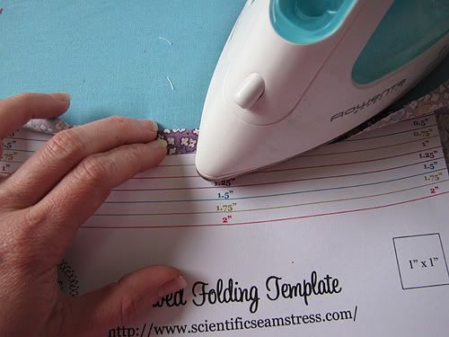 Free download of a folding seam template. What a clever woman to think of this! And how awesome that she is sharing it!