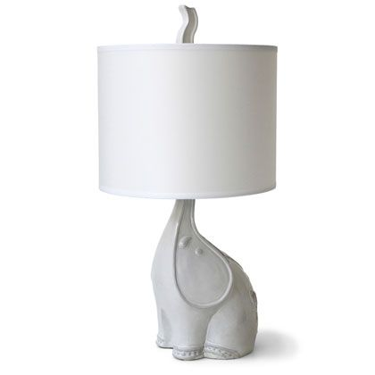 utopia elephant lamp from Jonathan Adler. Love how the trunk pops up through the shade.