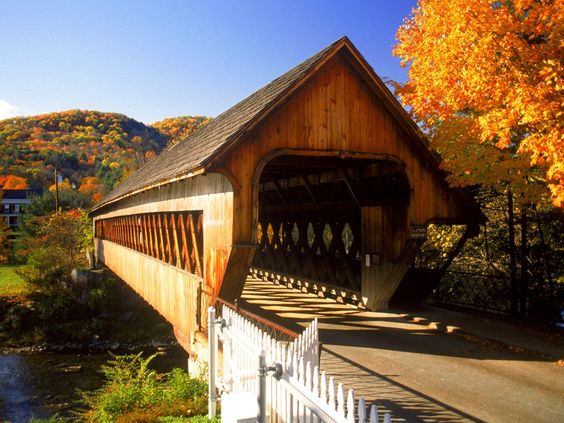 Woodstock Vermont.  The PERFECT most charming New England villiage. Covered bridges, antique shops,romantic B&Bs and a great general store. Visit in the fall!!: