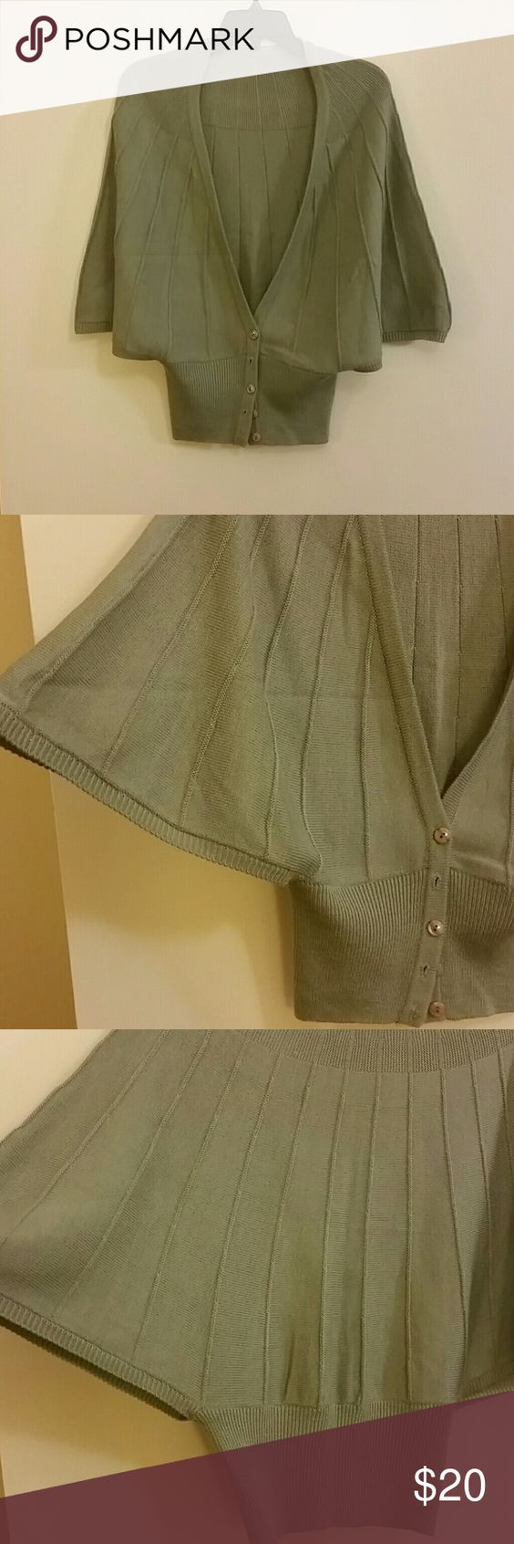 Grey shrug Classy but different race rug great for work great for fun. Button down cardigan Style with bat wings and snug waistline. Sweaters Shrugs & Ponchos