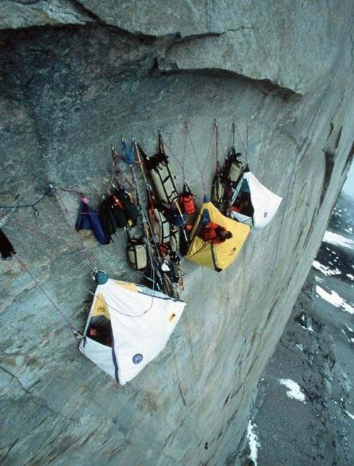 Extreme camping! their tents are suspended on the side of the cliff with ropes! Absolutely awesome (and frickin' scary!)