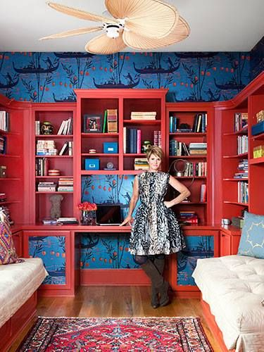 Make a built-in stand out. A bold red-orange—pulled from an Asian-motif wallpaper (cole & son Gondola) found by Colvin in London—energizes the library's built-in bookcases. Twin mattresses repurposed as daybeds are snug spots for all-day reading. #Design http://www.goodhousekeeping.com/home/decorating-ideas/colorful-decorating-ideas#slide-1