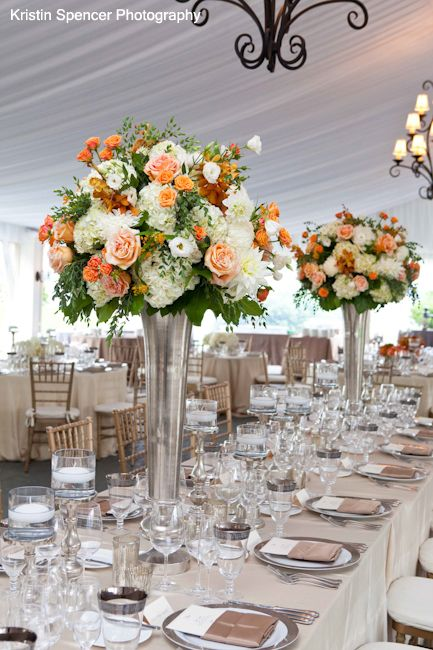 Tall centerpieces of flowers in stoneblossom s silver