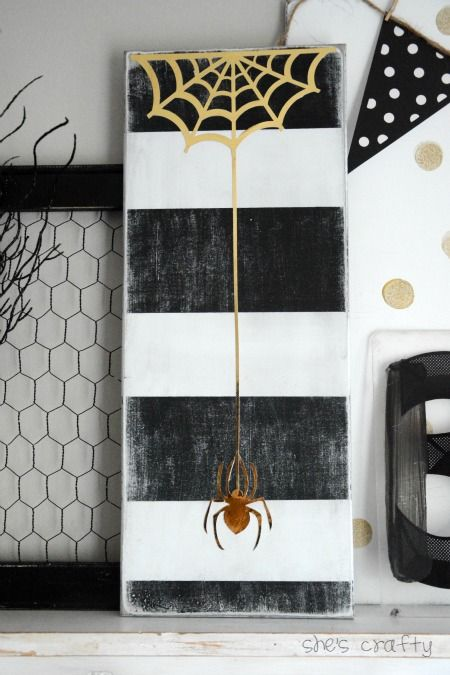Halloween Decor:  black and white stripes with gold spider