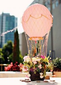 DIY Hot Air Balloon Centerpiece...using a basket of flowers, balloon filled with helium & craft store netting!!