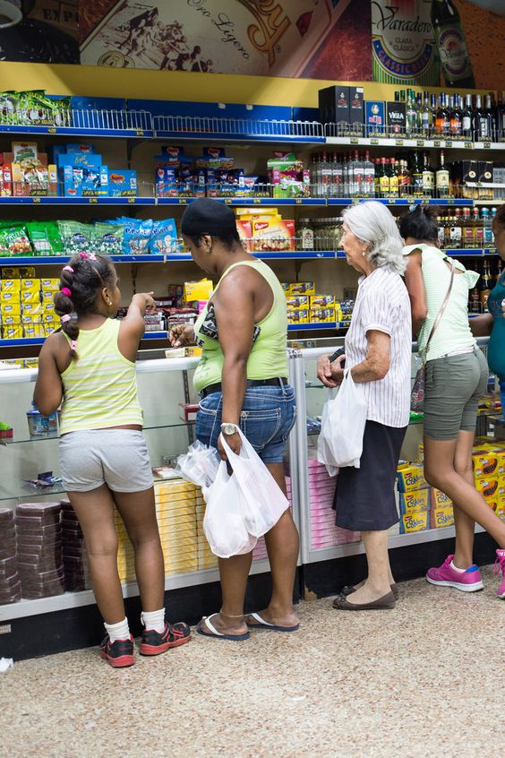 Shoppers at a supermercado in Havana that featured random leftovers from other countries, but no fresh meat or produce. (Photo: Lisette Poole for The New York Times)