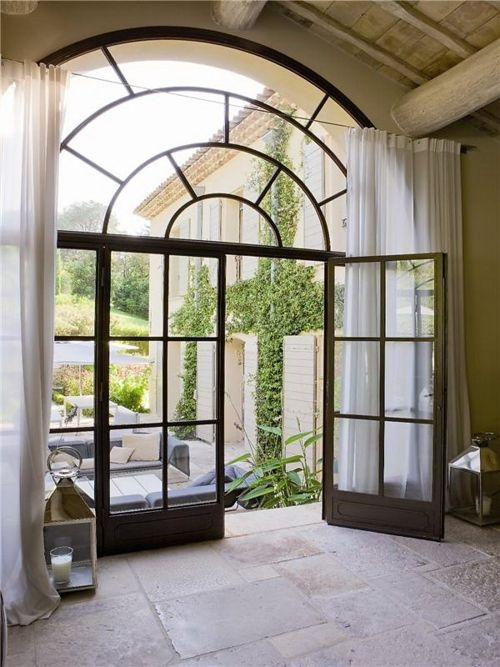 Paladium window with large French doors.                                                                                                                                                     More