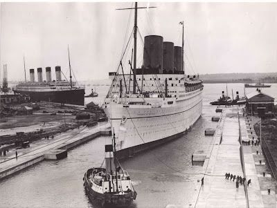The flagship RMS Empress of Britain II, behind which sits the RMS Olympic, sister ship to the RMS Titanic, bridging two eras of ocean transportation (c. 1931).