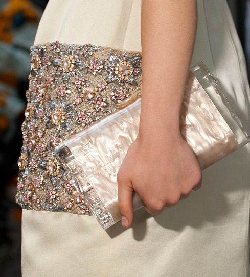 Interesting beaded pocket on a dress and the mother-of-pearl clutch.