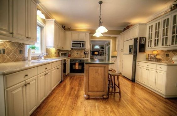 Traditional Kitchen with Flush, Crown molding, High ceiling, Wall sconce, Limestone Tile, Stone Tile, Breakfast bar, U-shaped