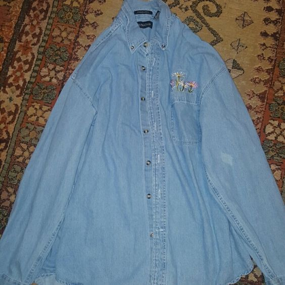 Daisy button-up shirt or it could be a jacket Has a spot on the left sleeve I have wash it and wash it won't come out whatever it is I try my best to get it out Other