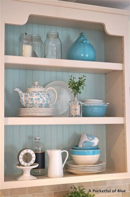 Cottage Style Kitchen Shelving.  Like the way the back is painted blue and that the shelves aren't overcrowded.