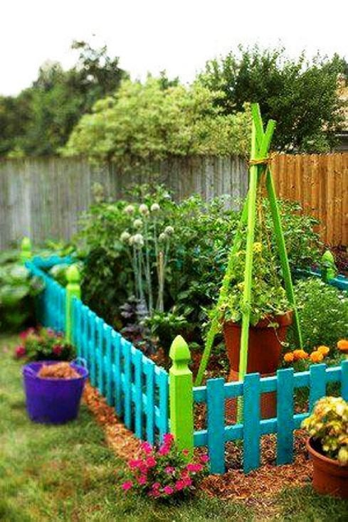 vegetable garden colorfully fenced off perfect with varro roaming around in