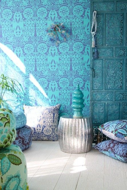 dark blue and turquoise combine nicely in these fabrics and in the wallpaper for a great bohemian effect: