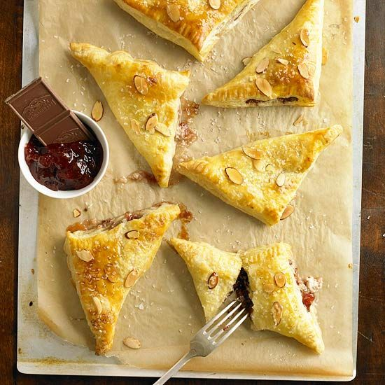 These pastry turnovers combine milk chocolate with sweet strawberry jam.