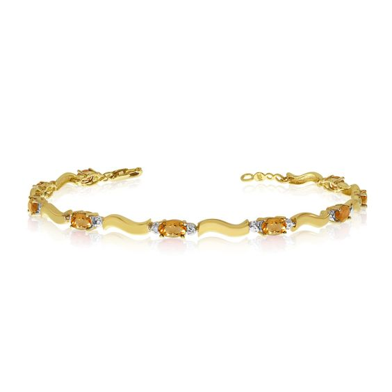 14K Yellow Gold Oval Citrine and Diamond Bracelet (9 Inch Length). Beautiful complimentary gift box included with this purchase. Setting made entirely with genuine solid 14 karat gold.