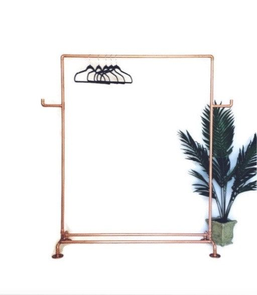 This beautiful clothing rack is made from industrial copper pipes and fittings…