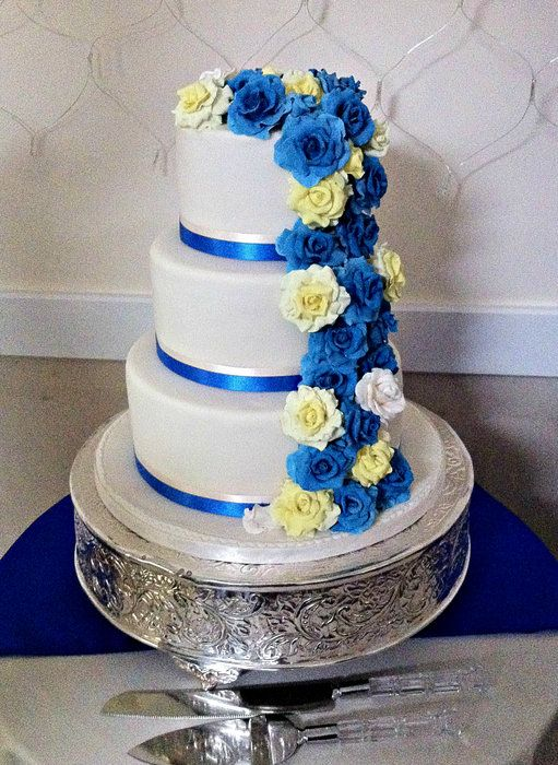 Yellow and royal blue wedding cakes