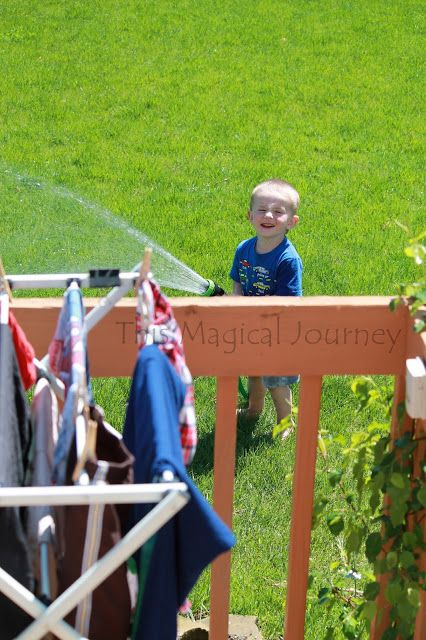 Motherhood Proverb: Laundry does not dry when the toddler has a hose.  But it sure makes for some great smiles.