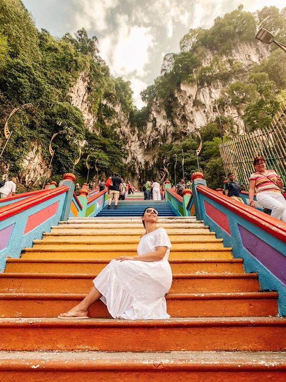 Have you always wanted to see the colourful steps of Batu Caves in Kuala Lumpur? It's one of my fave things to see and do with only 24 hours in Kuala Lumpur. Click through to read my Kuala Lumpur Malaysia Travel Guide! | Click through to read about my recommended things to do like Petrona towers, places to eat, Kuala Lumpur accommodation, Malaysia transportation, and more!