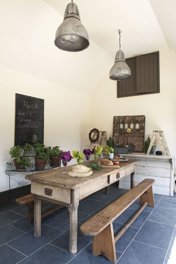 European farmhouse dining area with rustic farm table and bench. #frenchcountry #europeanfarmhouse #dining #rustic #farmtable