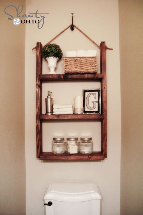 40+ Brilliant DIY Storage and Organization Hacks for Small Bathrooms --> Make a hanging bathroom shelf over the toilet