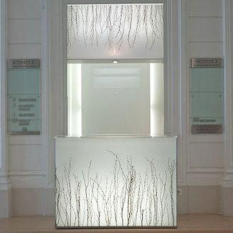 Courcelles - France. Designer: Borella Art Design.Glowing reception desk with Chroma Ghost and Birch Grove.
