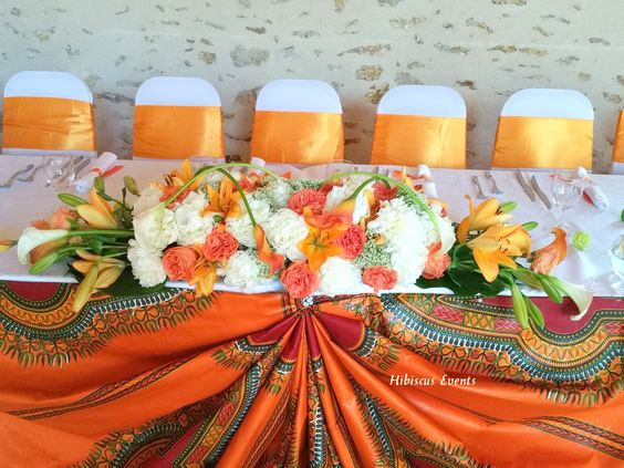 Mariage de Cory et Floris au domaine du parc (77) - Décoration en wax, dashiki, orange et blanc