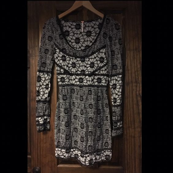 Free People Dress Black and white daisy pattern knit Free People dress.  Long sleeve.  Mid thigh length.  Fitted stretch material.  Size XS runs true to size throughout with room in the bust area.  Scoop neck is low cut.  Perfect condition! Free People Dresses Mini
