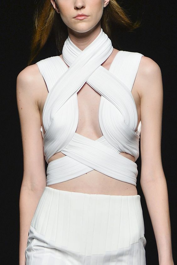 Sculptural fashion construction with intertwined pattern, elegant pleats & symmetry; all white fashion details // Dion Lee