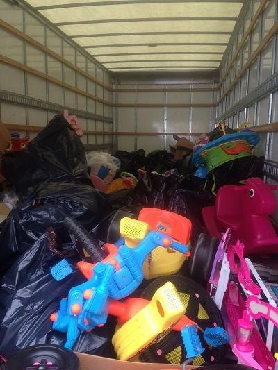 Cousino Harris filled three 40-foot box trucks with gently used toys to clean/sanitize and distribute to underprivileged children.