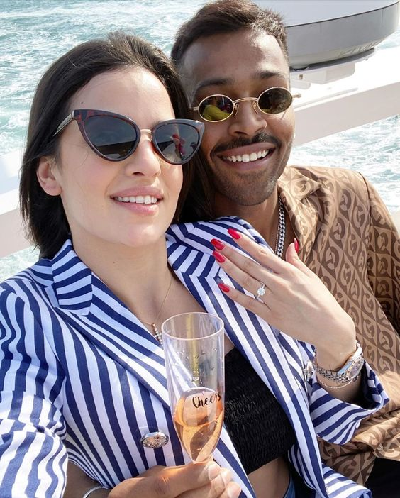 Hardik Pandya S Engagement To Natasa Stankovic On A Yacht Is Goals In 2020 With Images Engagement News Celebrity Weddings Romantic Style
