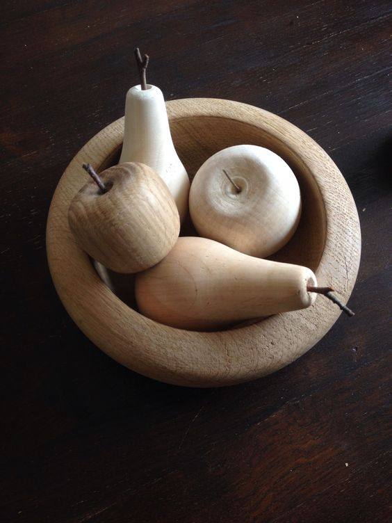 Bowl with apples and pears. Different wood.