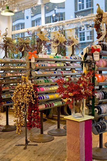 VV. Rouleaux in London. This unique shop, now on Marylebone Lane, is the largest retailer and wholesaler of ribbons and trimmings in Europe. It provides an extravagant variety of ribbons, trims, flowers, tassels, and feathers, as well as wool, chenille, and taffeta.