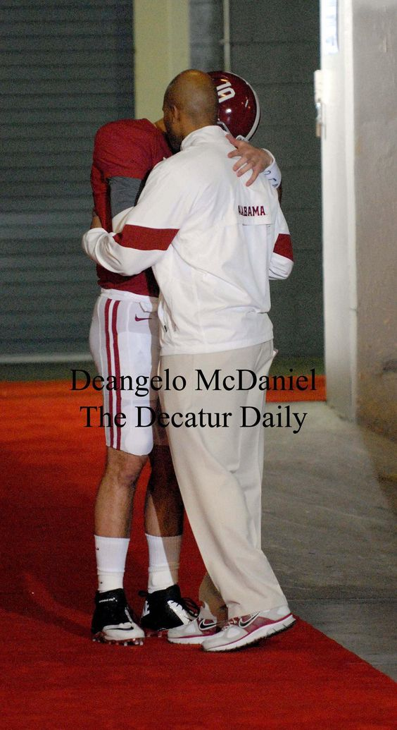 Awesome shot captured by Deangelo McDaniel of A.J. praying with a coach prior to hitting the field 1.9.12 to play LSU.