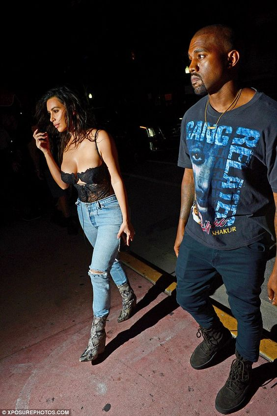 Tribute top: Kanye, meanwhile, wore a shirt which featured the face of the late rapper Tupac Shakur and read the name of his film, Gang Related