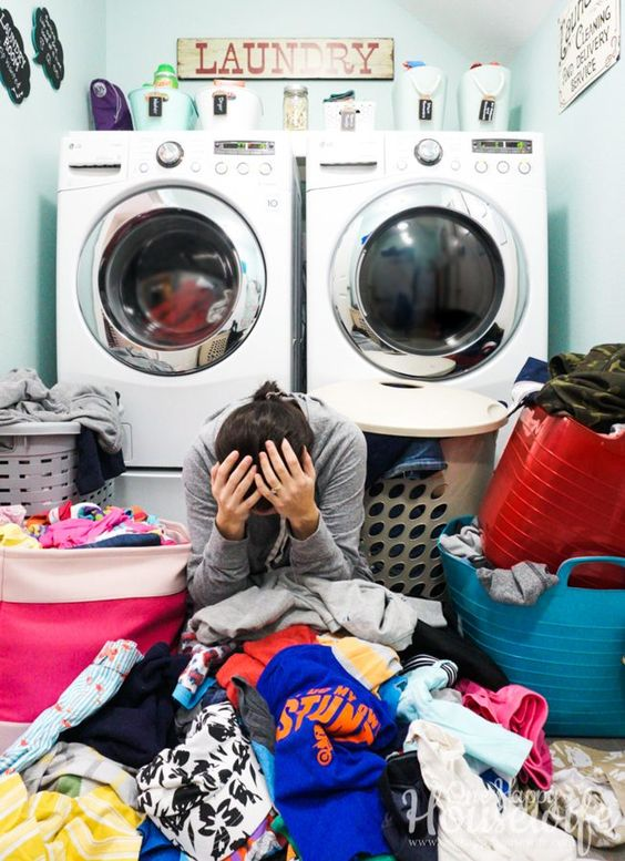me overwhelmed in a pile of laundry