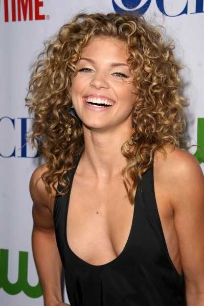 Love her curls....it's hard finding long, natural curl styles.