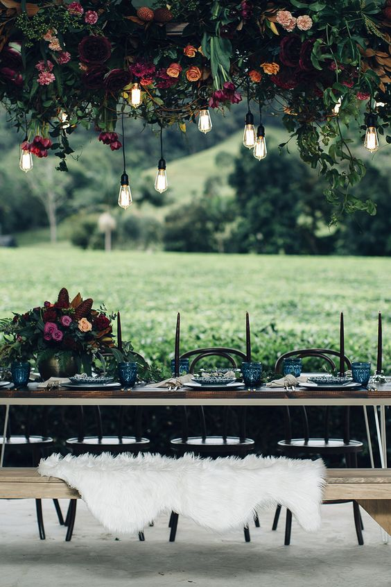hanging floral decor - photo by Figtree Pictures http://ruffledblog.com/moody-industrial-wedding-inspiration