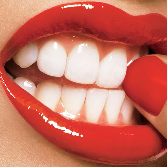 dang perfect teeth, great color lipstick and nail polish...im so jelly!
