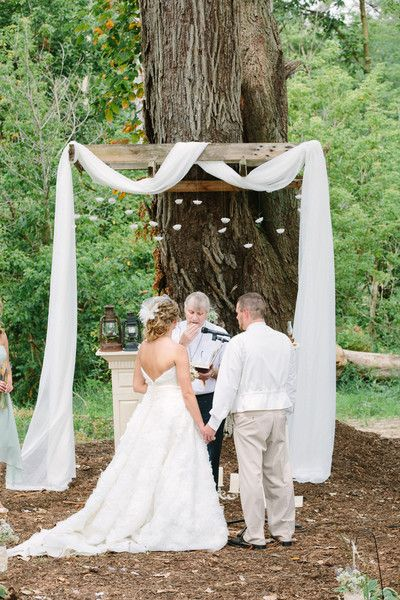 The altar was marked with a white sash and hanging origami swans that the bride and groom made themselves.   Bride's Gown: Allure Bridals  Music: Anthony Marchese  Rentals: Lori's Sew Special  Officiant: Donald Luhring