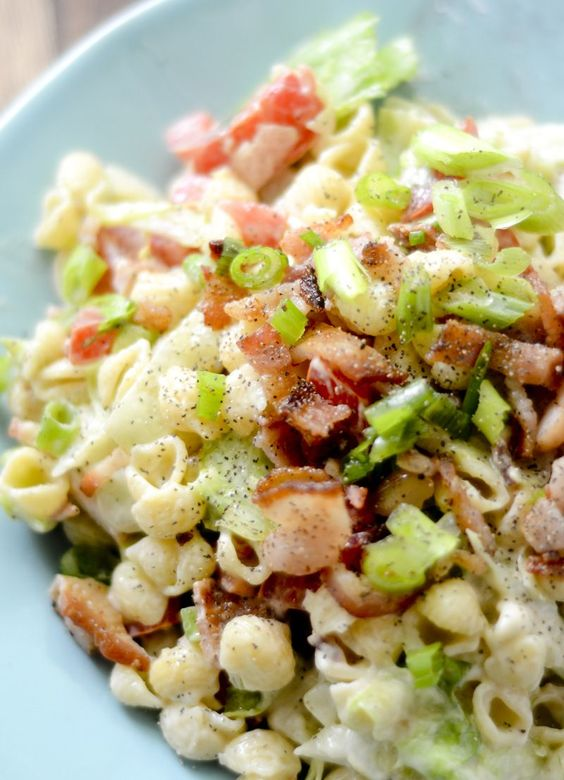 BLT pasta salad. 3 points plus / 1 cup       3⅔ cup large macaroni shells pasta, cooked     4 cup tomatoes, diced     4 slice bacon, cooked and crumbled     3 cup lettuce, thinly sliced     1 tsp sugar     2 tsp cider vinegar     ½ cup fat free mayonnaise     ⅓ cup light sour cream     1 tbsp dijon mustard     1 salt     1 pepper