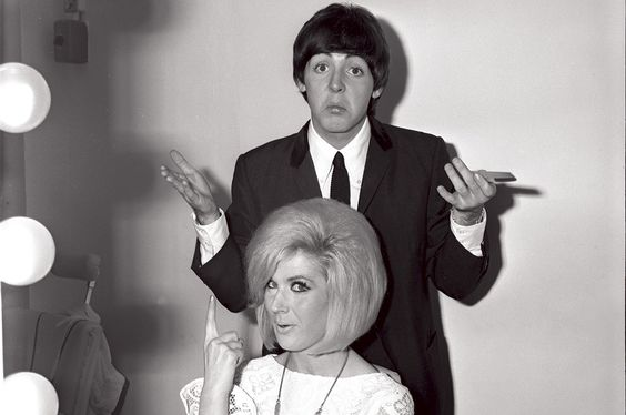 Paul doesn't look too sure about his new job as Dusty Springfield's hairdresser here.
