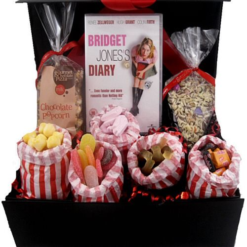 "This great ""chick flick movie night in"" gift box hamper comes with a choice of 7 DVDs and is filled with lots of nostalgic sweets, including cola bottles, pink shrimps, sour tongues, black jacks, fruit salads and bon bon's. As well as the fab pic n mix there is a delicious slice of chocolate pizza and chocolate drizzle popcorn"